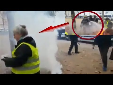 Champs Elysées gilets jaunes agression crs des vieilles personnes