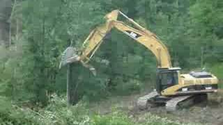 CAT 330C Hydraulic Excavator tearing down trees (4/4)
