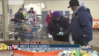 Snow shrinks supplies, lines at Indianapolis food banks