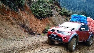 Mitsubishi Strada Toyota Hilux and Isuzu D max heavy loads on muddy roads in high climb