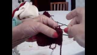 Barra de tricô para decote