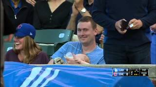 Repeat youtube video Man Catches Baseball While Holding Baby