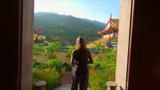 Steadycam Shot of Family Visiting a Kek Lok Si Temple on Penang Island, Malaysia | Stock Footage -