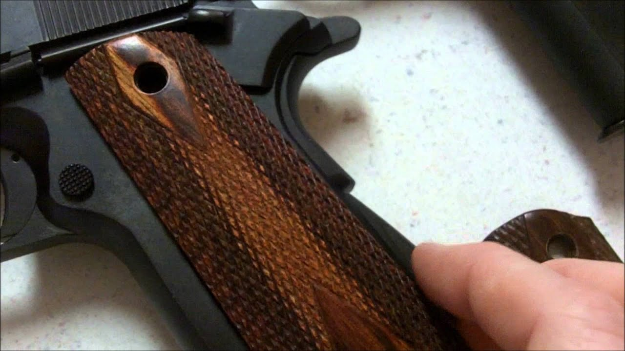 can standard colt 1911 grips be swapped with denix replica