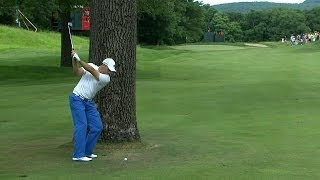 sergio garcia reroutes from behind a tree on no 10 at travelers