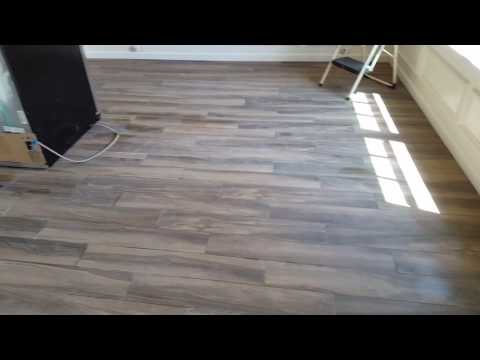 Install tile floor downstairs porcelain 6x32  looks like Wood