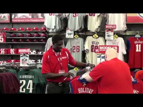 Jrue Holiday as Modell's Employee Selling His Own Jersey
