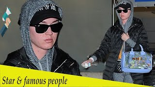 Katy Perry goes incognito at LAX as she returns from Prague getaway
