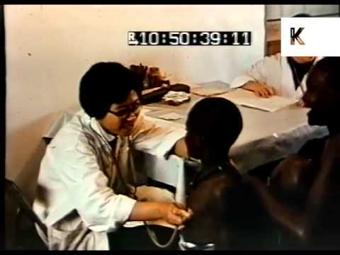 1970s Chinese Doctors Treat African Women and Children, Africa, Colour Archive Footage