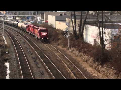 CP Rail GP38s pulls out with the tank train