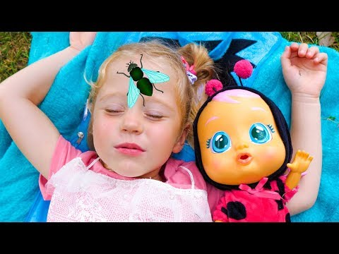 Stacy and baby doll sleeping at park