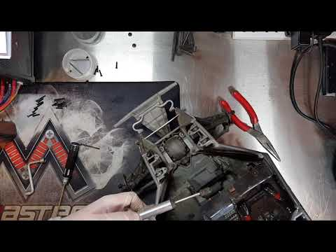Repeat Traxxas UDR front shock removal and upgrade oil    by
