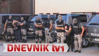 Kriminalci u policijskim redovima