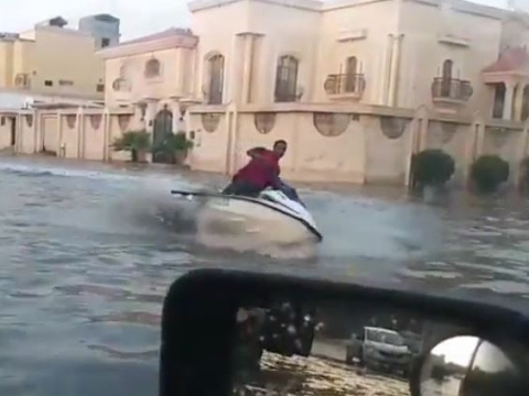 Man Rides Jet Ski During Flooding in Saudi Arabia