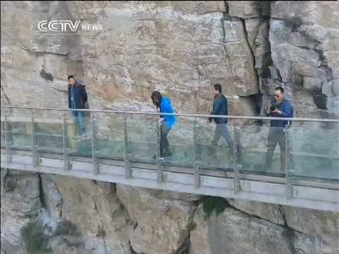 Glass walkway on cliff edge in China sees nervous travelers
