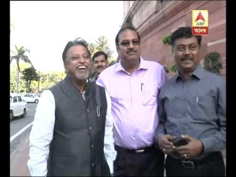 Rebel tmc mla Swapankanti Ghosh touches Mukul Roy's feet in new delhi.