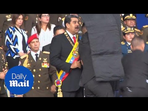 Police shield Venezuela's President after 'assassination attempt' - Daily Mail