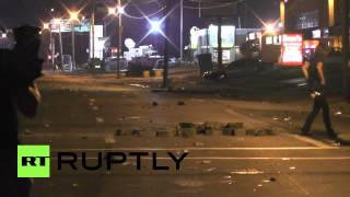 USA: Smashed glass and broken paving stones cover Ferguson