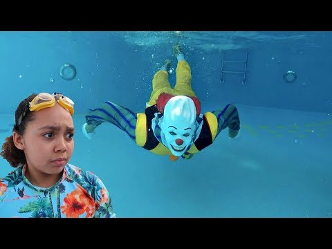 SCARY CLOWN IN OUR SWIMMING POOL!!
