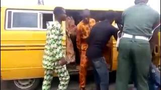 BABARIC!  Nigerian soldier beats bus conductor to pulp and threatens to shoot him