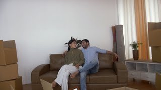 Young Indian man and woman feeling tired after placing couch/ sofa at new flat