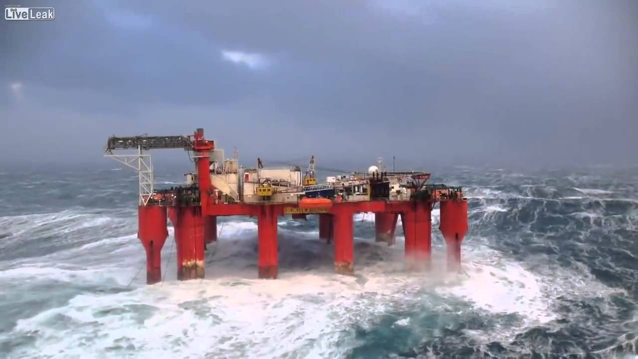 Huge waves crash against swaying North Sea oil rig - YouTube