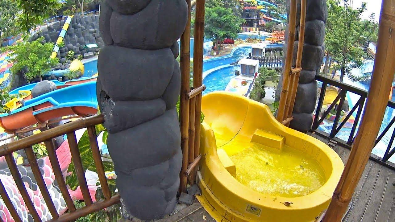 yellow koi water slide at kediri waterpark