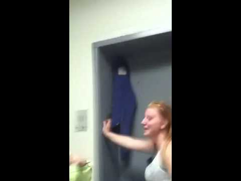 Asian girl stuck in elevator