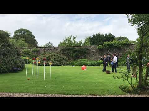 Leighton Hall   Guests playing the Coconut Shy in the Garden