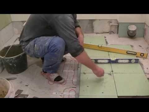 видео: Как уложить плитку в ванной