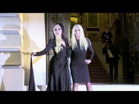 Lady Gaga and Donatella Versace photocall at 2014 Versace show in Paris