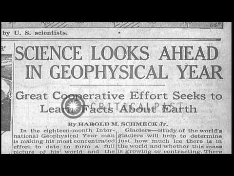 New York Times headlines about the Geophysical Year. HD Stock Footage