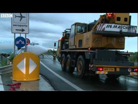 Cargo plane overshoots runway in Italy   BBC News