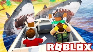 SURVIVE A SHARK ATTACK IN ROBLOX! (Roblox Shark Bite)