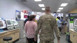 Soldier surprises wife and meets newborn son for the first time