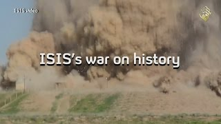 ISIS vandals smash up ancient sites in war on history
