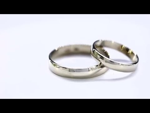 white-golden-wedding-rings-rotating-stock-video