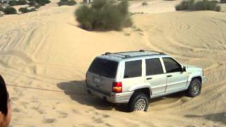 Car stuck in desert in dubai