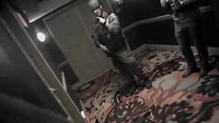 Las Vegas police bodycam shows storming of gunman's hotel room