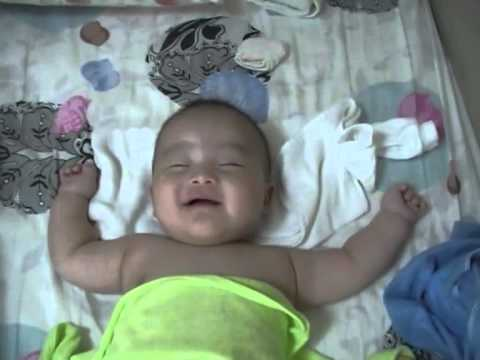 Baby laughing while is asleep :))