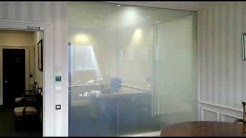 Intelligent Glass smart glass partition wall between reception and a meeting room