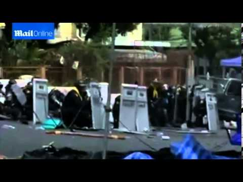 Thai police officer among four killed and dozens wounded as fierce gun battles erupt in Bangkok