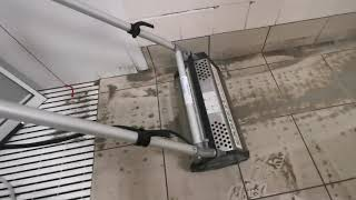 Tile wetroom floor scrubbing. Very satisfying