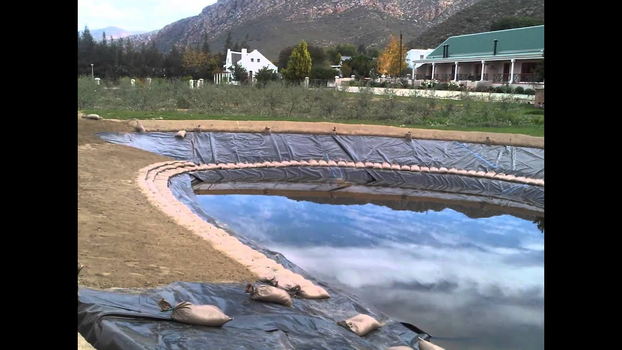Power plastics industrial covers and liners dam liner for Building a large pond