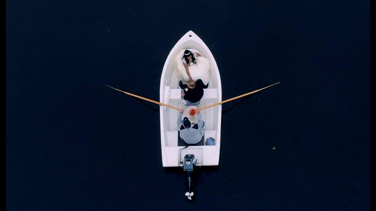 Swedish lake wedding with boat entrance - a Covid 19 wedding