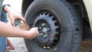 Properly tighten lug nuts with pneumatic impact gun