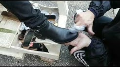 Shoeshine at work on woman shoes - Rome - Italy