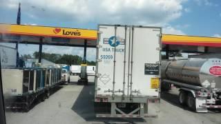 USA TRUCK Blocking Fuel Island at Loves travel center in Willis Texas