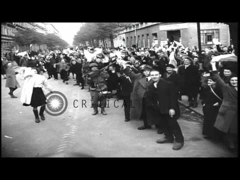 United States Infantry troops patrol with Sherman Tanks on streets of Leipzig, Ge...HD Stock Footage