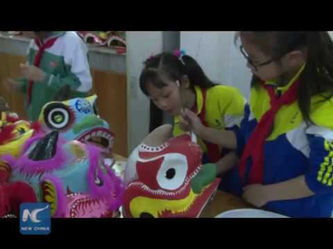 Chinese dancing lion heads popular in primary school in S China